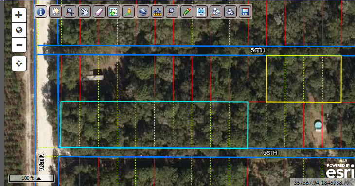 Rare find – 10 side by side lots – corner lot – .92 acres – Buildable!  Florida land for sale by owner!  Build your dream cottage here!  7 minutes from Suwannee River!